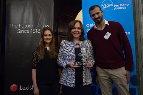 Best Contribution by an In-House Team  Nadine Morgan and Mohammed Karim, Microsoft Limited, receiving the award from Hilarie Bass (President, American Bar Association)